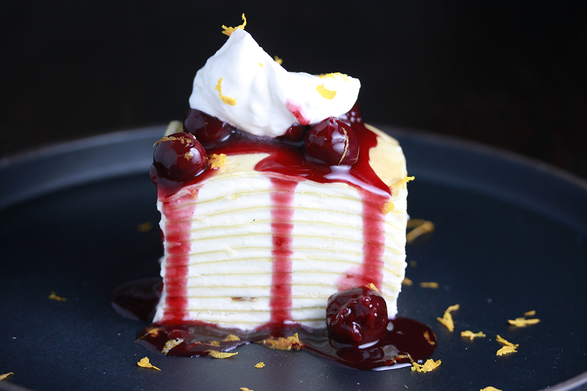 Crepe Cake topped with Haliburton cherry orange compote