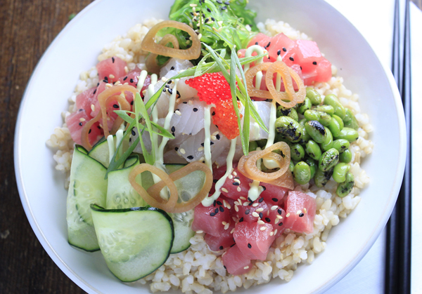 Ahi and Kampachi Poke Bowl featuring Haliburton Citrus Miso Vinaigrette, Fire Roasted Edamame, Pickled Soya Onions, and Wasabi Avocado Crema