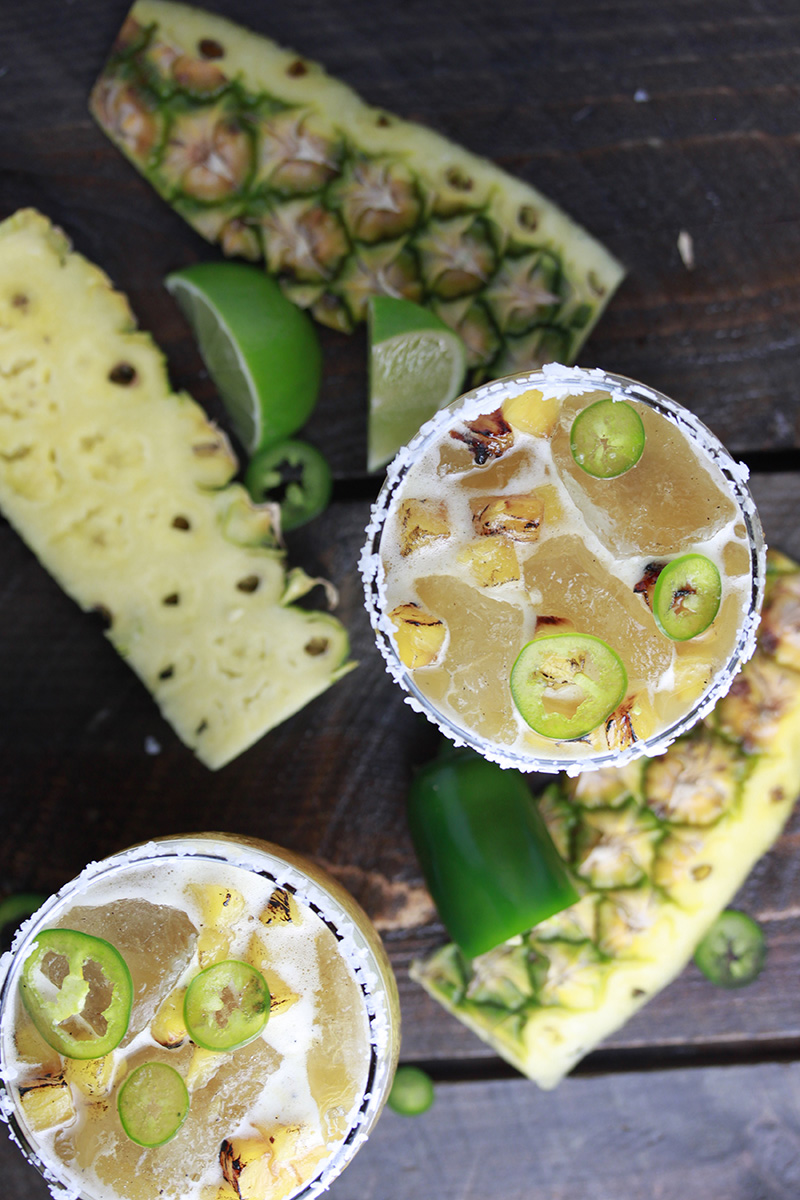 Spicy Pineapple Margarita features fire roasted pineapple purée with roasted pineapple and jalapeño