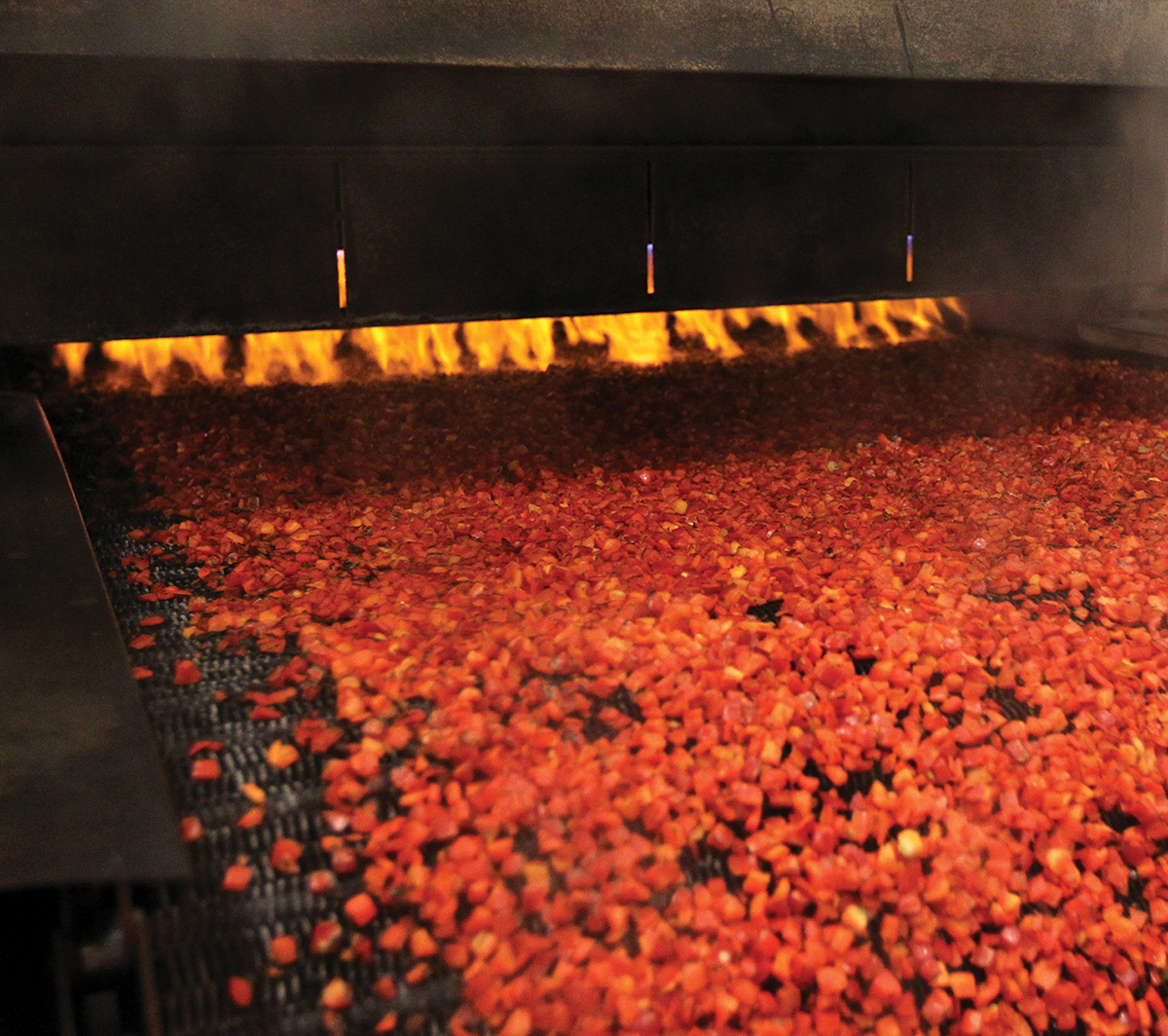 Diced Red Bell Peppers being flame roasted
