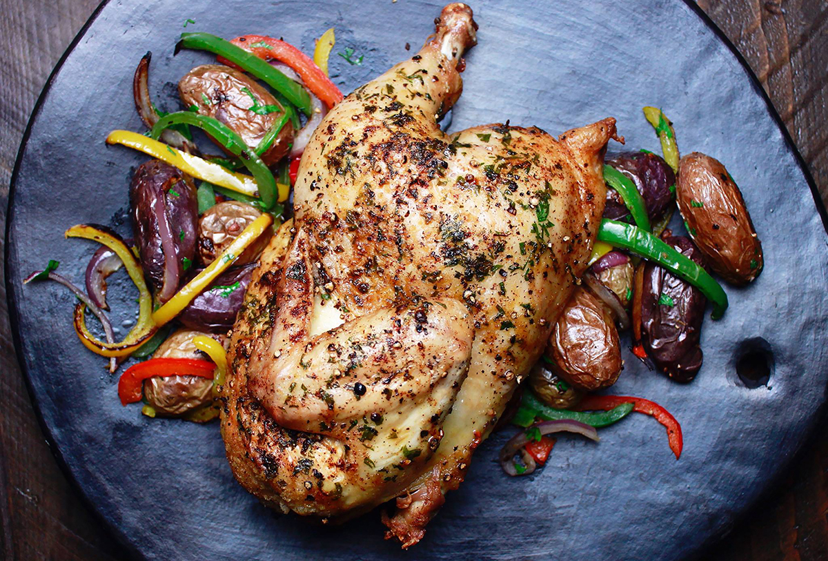 Herb roasted Half Chicken featuring Haliburton Fire Roasted Bell Peppers and Onions