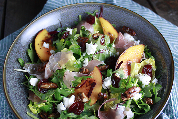 Roasted Peach and Prosciutto Salad featuring Haliburton Pickled Blueberries